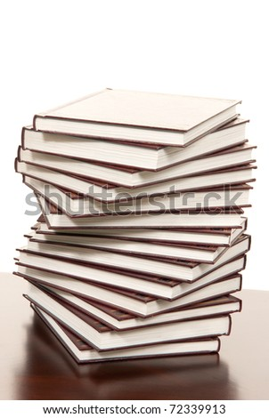Stack of real books in wound formation, leather binder side view, isolated on white background