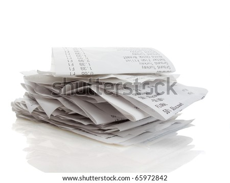 Stack of receipts piled high on white background - stock photo