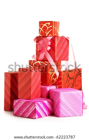 Stack of red and pink gifts isolated on white background. - stock photo