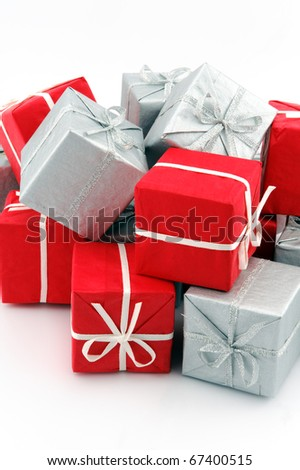 Stack of red and silver gift boxes on white background - stock photo