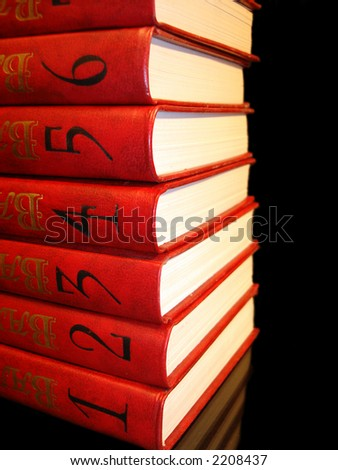 stack of red books with numbers on black background - stock photo