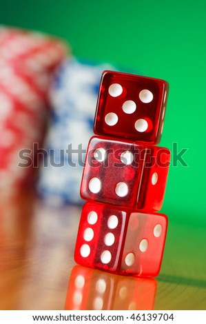 Stack of red casino dice against gradient background