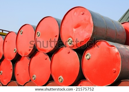 Stack of red drums for industrial use - stock photo