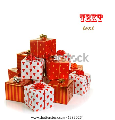stack of red gift boxes decorated with bow isolated on white - stock photo
