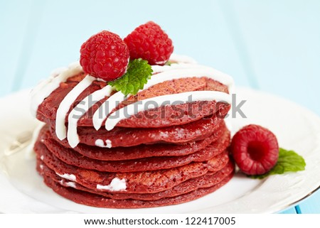 Stack of Red Velvet Pancakes with Raspberry - stock photo