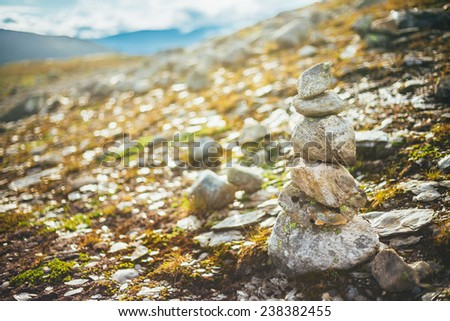 Stack Of Rocks Stones On Norwegian Mountain, Norway Nature. Toned Instant Photo - stock photo