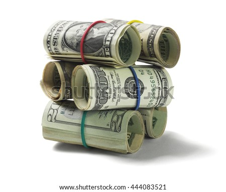 Stack of Rolled Up US Dollar Bills on White Background - stock photo