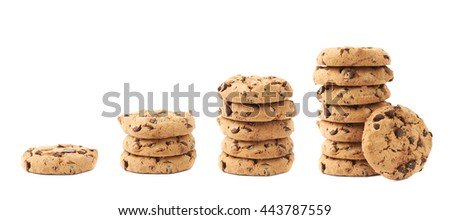 Stack of round cookies with the pieces of chocolate isolated over the white background - stock photo