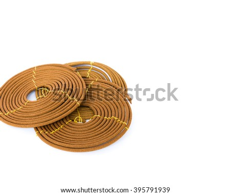 Stack of round incense or citronella spiral coil isolated on white. Made from pure ingredients, natural glue with long burn time. It has mild, lasting fragrance. Meditation, worship concept,copy space