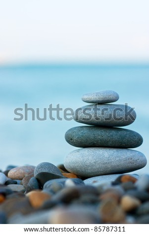 Stack of round smooth stones on a seashore - stock photo
