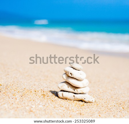 Stack of round stones on a seashore - stock photo