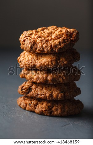 Stack of round wheat cookies isolated on dark gray background. - stock photo