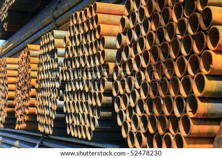 stack of rounded steel pipes - stock photo