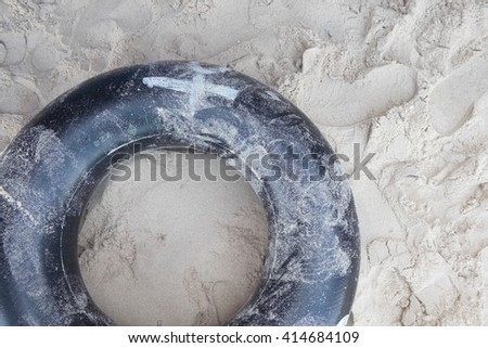 Stack of rubber tires from a beach - stock photo