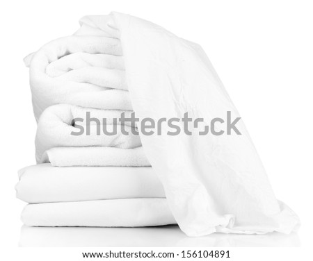 Stack of rumpled bedding sheets isolated on white