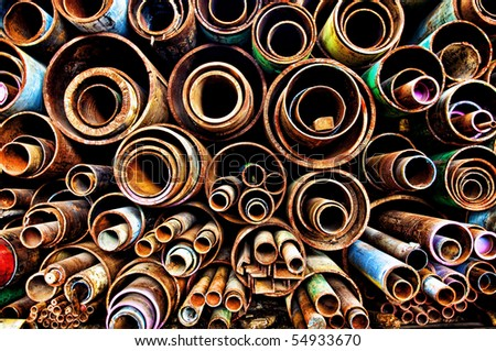 Stack of rusty steel pipes