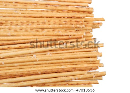 Stack of salted breadsticks isolated on white