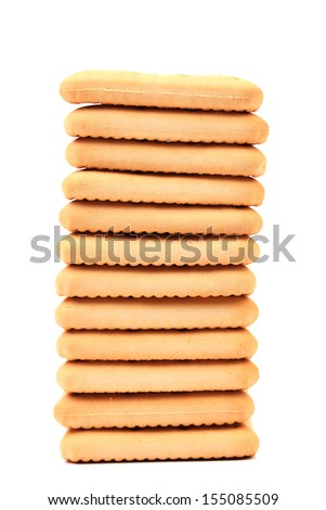 Stack of saltine soda crackers. Isolated on a white background
