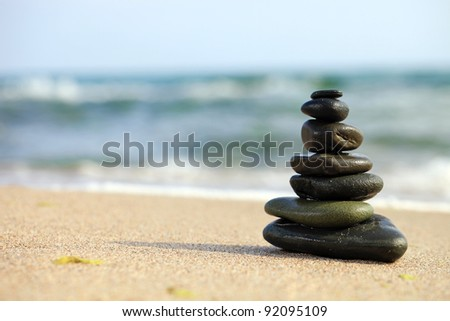 Stack of sea pebbles on the beach - stock photo