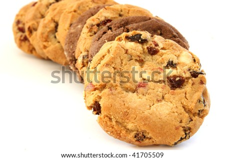 Stack of several chocolate and hazelnut cookies with chocolate chips and cranberries - stock photo