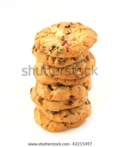 Stack of several chocolate chip hazelnut cookies with cranberries - stock photo