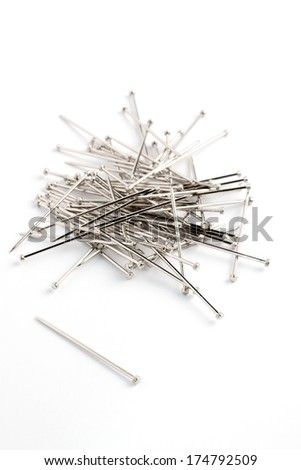 Stack of sewing or textile pins studio isolated - stock photo
