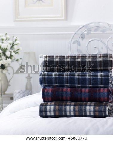 Stack of sheets on bed. - stock photo