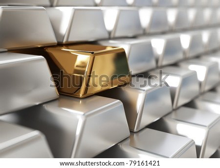 Stack of silver ingots with one golden - stock photo