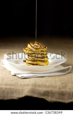 Stack of Small pancakes in syrup - stock photo