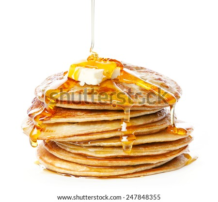 Stack of Small pancakes in syrup on white background - stock photo
