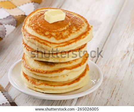 Stack of Small pancakes on  white wooden table.