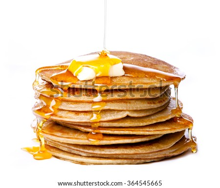 Stack of Small pancakes with butter and honey syrup on white background - stock photo