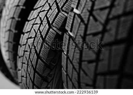 Stack of snow tyres - stock photo