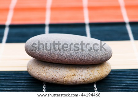 Stack of spa pebbles against blurred background