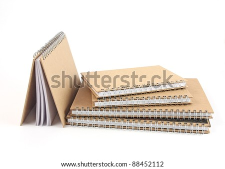 stack of spiral notebooks isolated on white - stock photo