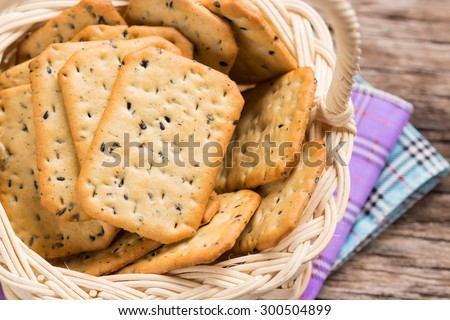 Stack of square crackers in basket. - stock photo