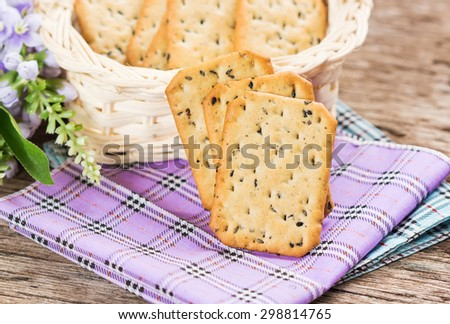 Stack of square crackers on napkin. - stock photo