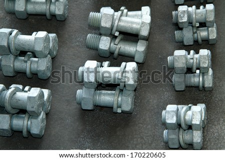Stack of steel Bolt & nuts - stock photo