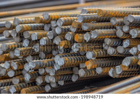 Stack of steel reinforcement rods for construction, background. Selective focus. - stock photo