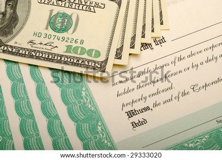 Stack of Stock Certificates and Dollar Bills - stock photo