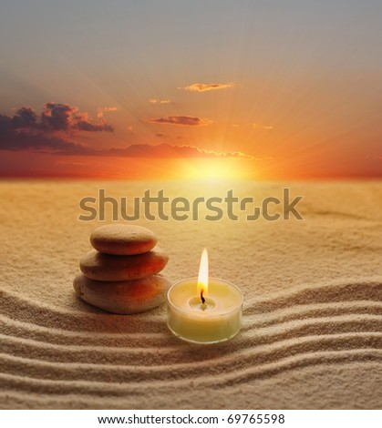 stack of stones and candle light - stock photo
