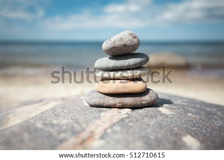 Stack of stones on the seaside in summer