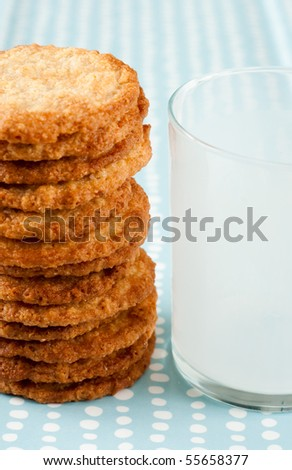 Stack of Sugar Cookies and Empty Glass of Milk - stock photo