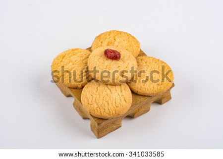 Stack of sweet meal digestive biscuits isolated on white. - stock photo
