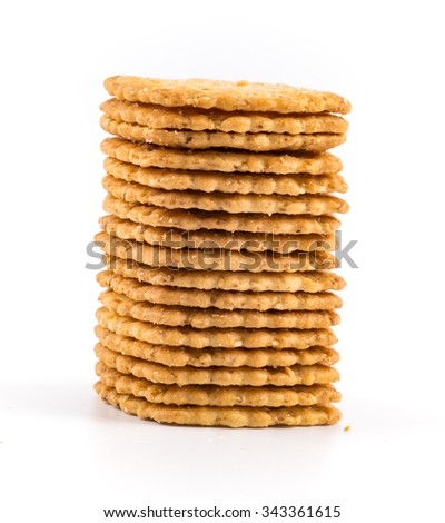 Stack of sweet meal digestive biscuits isolated on white.