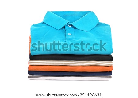 stack of T-shirts on a white background - stock photo