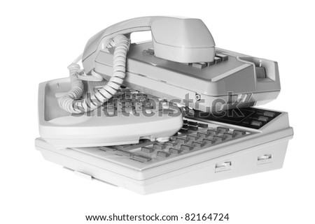 Stack of Telephones on White Background