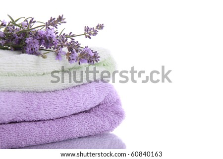 Stack of terry towels with lavender flowers and beautiful reflection - stock photo