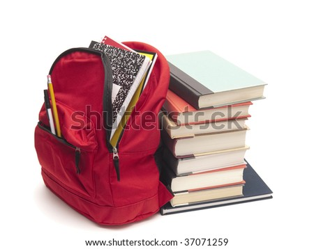 Stack of textbooks beside school backpack - stock photo