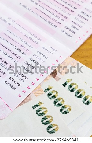 stack of thai banknote and Account Passbook - stock photo